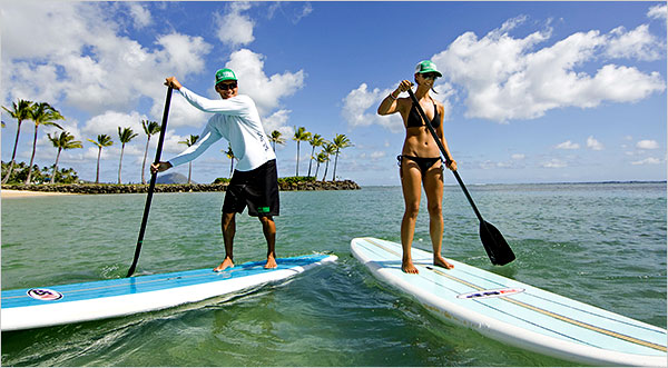 couple on stand up paddleboard