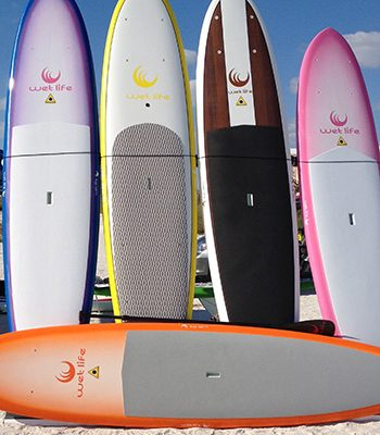 paddle boards standing in the sand