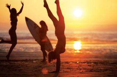 girls on sundown by the beach